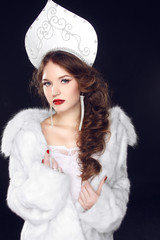 Fashion Russian girl model in Slavic exclusive design clothes on