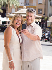 Romantic senior mature couple taking selfie photo on vacation