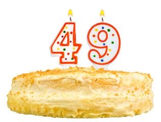 birthday cake with candles number forty nine isolated on white