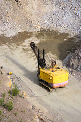 yellow excavator stonecutter