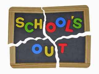 Schools out in colored letters written on broken school slate