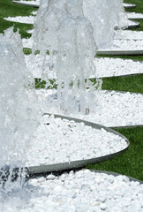 Row of cascading jets on ornamental fountains