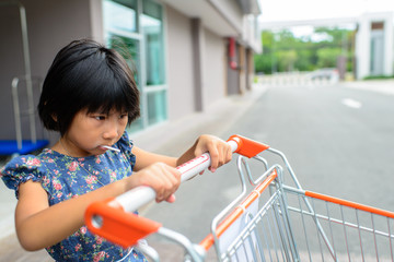 Girl with shopping cart.