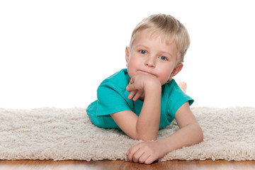 Pensive little boy resting