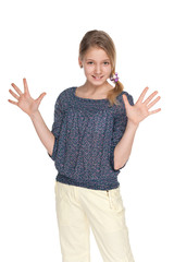 Preteen girl makes a hands gesture