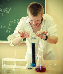 Crazy scientist at laboratory on chemical experiment