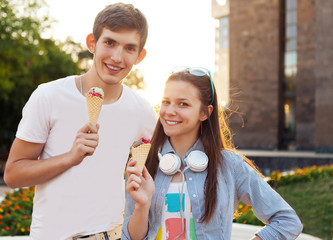 Cute young beautiful teen couple with ice cream