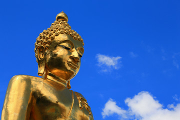 Golden statue of Buddha with Blue sky