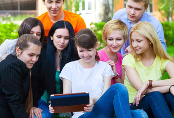 Young college students using tablet computer