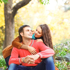 Portrait of couple enjoying golden autumn