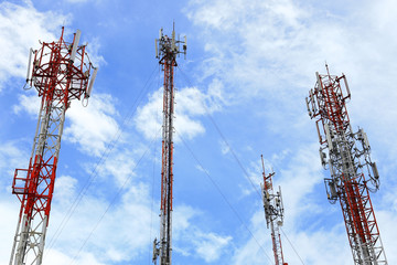 Multiple Telecommunication Towers with blue sky