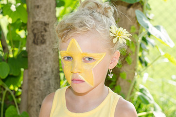 girl with star face painting