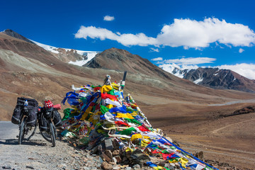 Two bicycles near prayer flags, North India