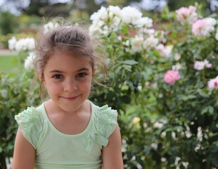 Smiling little girl and flowers