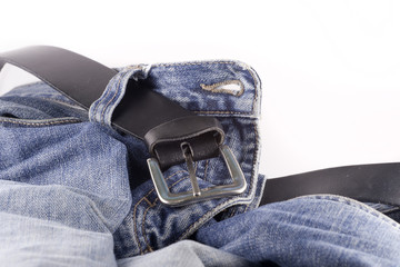 Blue jeans and a black leather belt