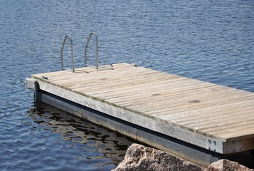 Floating wooden swimming dock