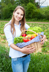 Blonde woman with vegetables fresh from the field