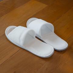 white Slipper on wood floor