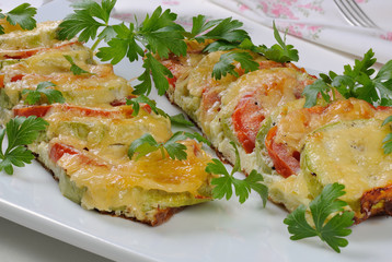 Baked zucchini with tomatoes and cheese