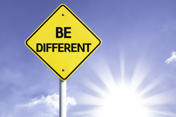 Be Different road sign with sun background