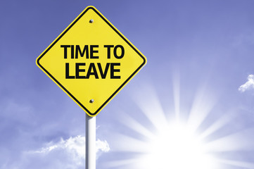 Time to Leave road sign with sun background