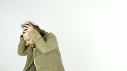Funny man with long hair and beard dancing in studio isolated