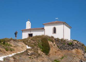 Little chapel and man