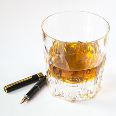 Whiskey glass and fountain pen, creativity and lifestyle