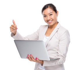 Business woman with laptop computer and thumb up