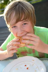boy is eating hamburger