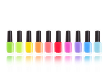 Nail polishes. Manicure rainbow isolated on white.