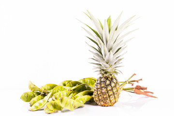 Parkia speciosa and Pineapple on white background.