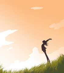 Silhouette Girl in the Field and the Evening Sky