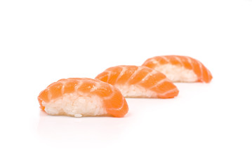 Three Sushi with Salmon isolated on white