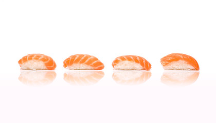 Four Sushi with Salmon in line with reflection isolated on white