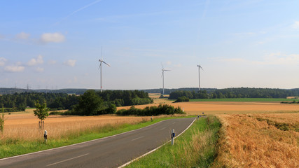 wind power plant in a field at sunraise