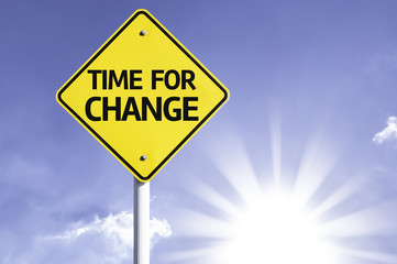 Time for Change road sign with sun background