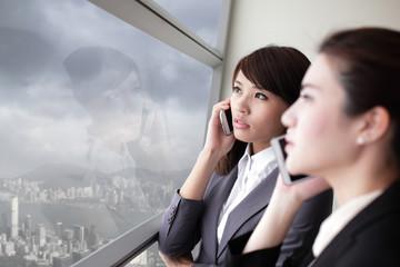 Business team look city through window