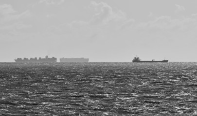 Italy, Sicily, Mediterranean sea, cargo ships and an oil thank