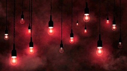 Incandescent bulbs hanging, smoke in motion, red background