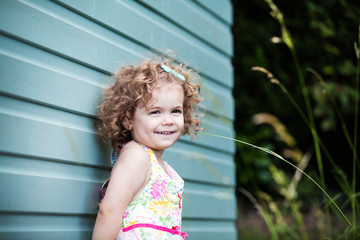 little girl smiling in garden