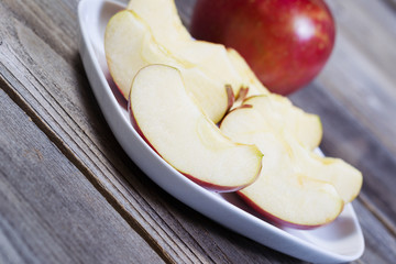 Angled View of Apple Slices on White Plate