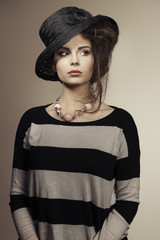 trendy woman with black hat