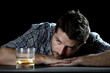 alcoholic man trying to fight against alcohol addiction - 67632798