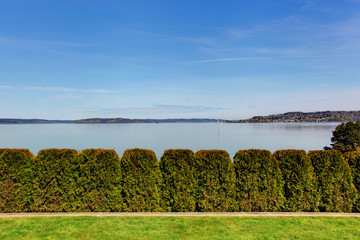 Beautiful view of bay and trimmed hedges