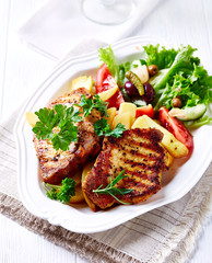 Grilled Pork with French Fries and Salad