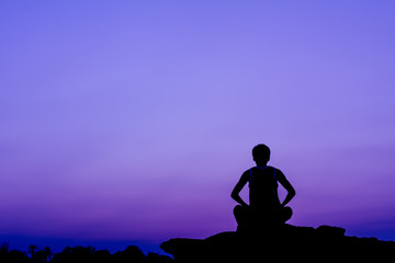 Silhouette of a man in meditation posting