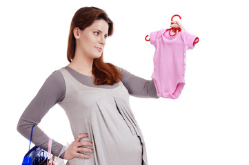 Happy pregnant woman making shopping for her baby studio shot