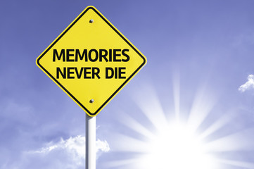 Memories Never Die road sign with sun background