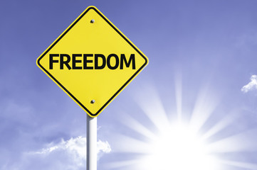 Freedom road sign with sun background